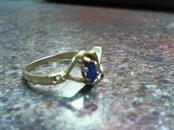 10k ladies yellow gold ring w/ blue center stone